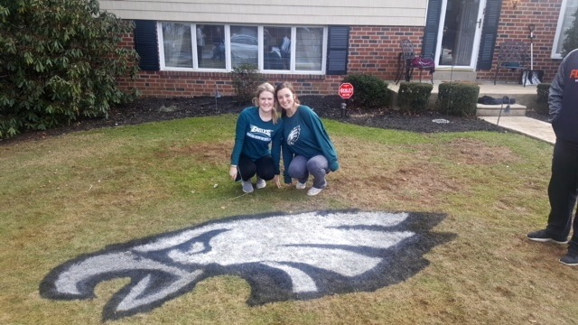 Lauren Bruton and Erin Lynch helped stencil 10 lawns with the Eagles logo in their neighborhood in Delaware County, south of Philadelphia. (Courtesy of Paul Bruton)