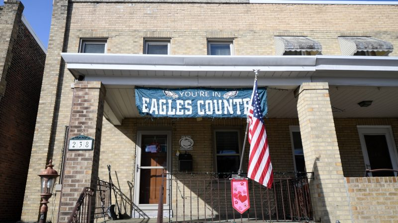 A flag in support of the Philadelphia Eagles hangs on the front porch of a home in Roxborough, on Wednesday. (Bastiaan Slabbers for WHYY)