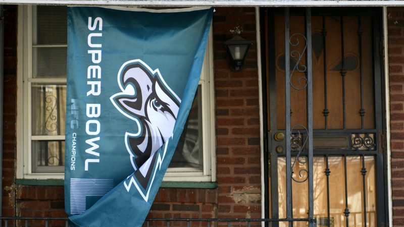 Flag in support of the Philadelphia Eagles hang on the front porch of a home in Roxborough, on Wednesday. (Bastiaan Slabbers for WHYY)