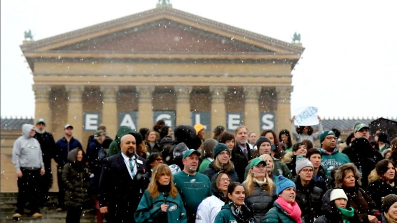 Philadelphia Museum of Art staff members sing the Eagles fight song on the Rocky steps. (Kimberly Paynter/WHYY)