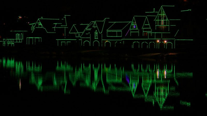 Boathouse Row glows green Thursday night in support of the Eagles. (Emma Lee/WHYY)