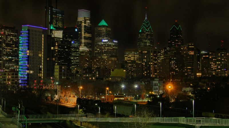 Many of Philadelphia's buildings are lit up with green lights in celebration of the Eagles' advancement to the Super Bowl. (Emma Lee/WHYY)