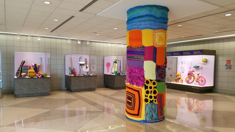 A yarnbomb installation at the Philadelphia airport by the street artist Marbufs. (Peter Crimmins/WHYY)