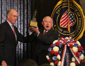 Attorney General Jeff Sessions (right) receives the Lincoln Award from Union League President James P. Dunigan. Sessions was the keynote speaker at the Union League's Lincoln Day celebration. (Emma Lee/WHYY)