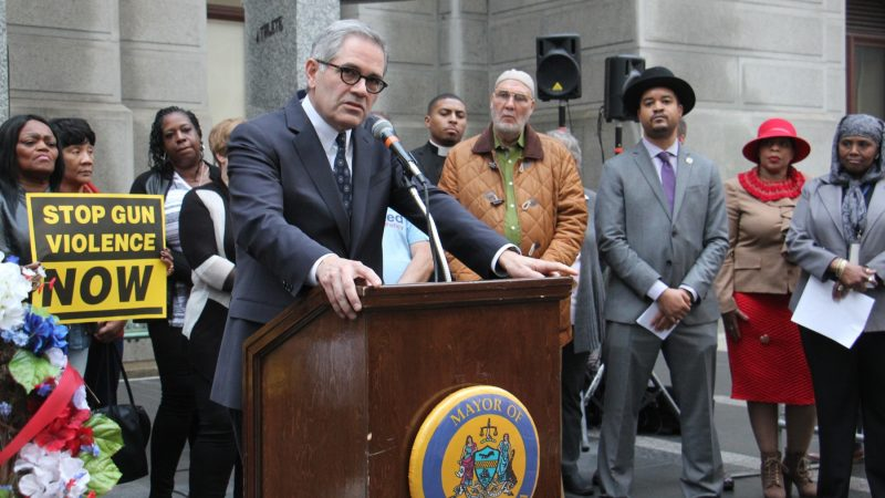 Philadelphia District Attorney Larry Krasner calls for a ban on assault rifles during a vigil for victims of gun violence at City Hall. (Emma Lee/WHYY)