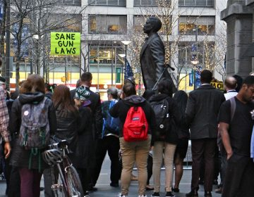 About 50 people gathered at the statue of Octavius Catto to remember the victims of gun violence and to call for gun control legislation. (Emma Lee/WHYY)