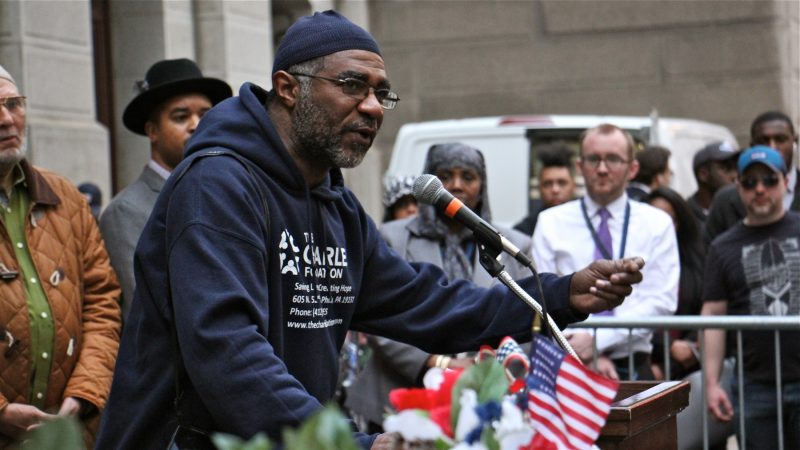 Yancey Harrell, whose youngest son, Charles, was shot to death six years ago, speaks during a vigil to remember the victims of gun violence. (Emma Lee/WHYY)