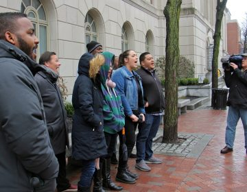 A dozen representatives of For Our Future political action committee chant outside Sen. Pat Toomey's Philadelphia office in support DACA (Deferred Action for Childhood Arrivals).
