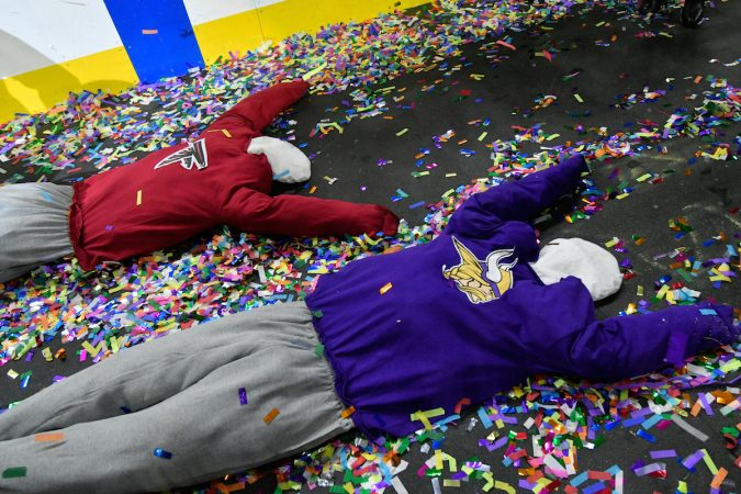 Puppets in Patriots and Vikings shirts are dragged behind an Eagles-themed float during the annual Wing Bowl competition, at the Wells Fargo Center, on Friday. (Bastiaan Slabbers for WHYY)