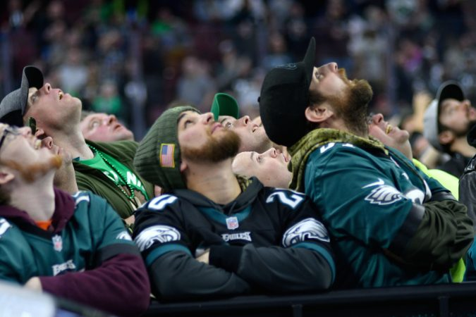 Fans look up at the big screen in the center fo the arena to follow what happens on stage during the Wing Bowl 26, at the Wells Fargo Center, on Friday.  (Bastiaan Slabbers for WHYY)