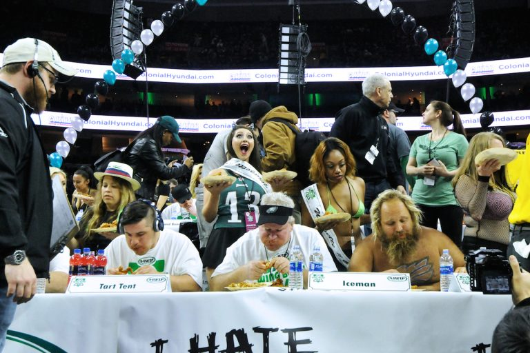 Two days ahead of Super Bowl LII, competitive eaters consume large amounts of wings during the annual Wing Bowl competition at the Wells Fargo Center. (Bastiaan Slabbers for WHYY)