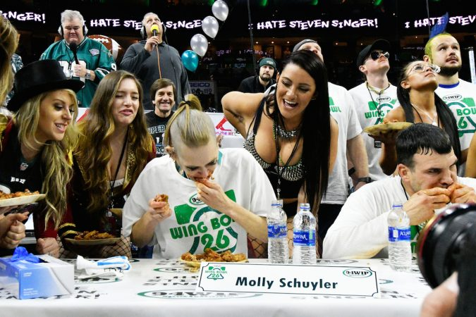 Molly Schuyler competing for the win during Wing Bowl 26, at the Wells Fargo Center, on Friday. (Bastiaan Slabbers for WHYY)