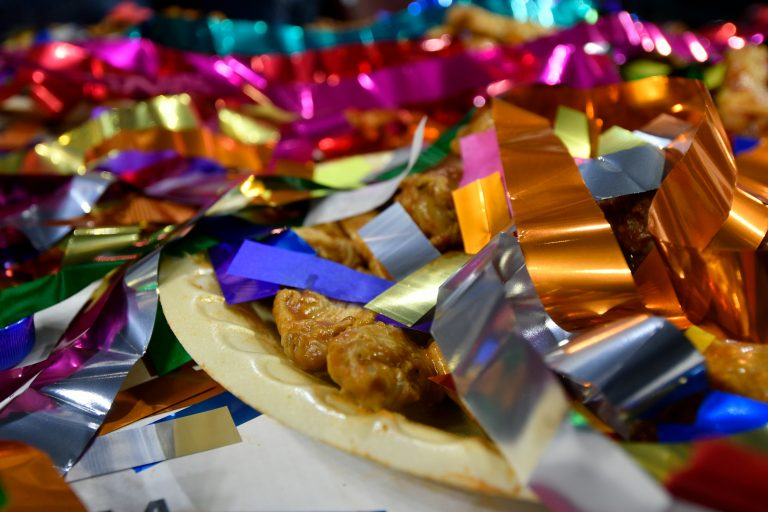 Confetti covers left over wings after competitive eater Molly Schuyler takes the crown for winning the Wing Bowl 26, at the Wells Fargo Center, on Friday.  (Bastiaan Slabbers for WHYY)