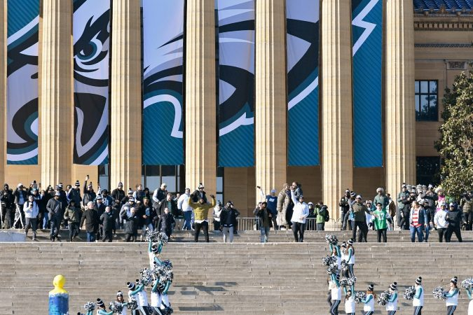 Eagles team members walk down the Art Museum steps in front of hundreds of thousands at the Parkway in Philadelphia, PA, on February 8, 2018, to celebrate the Philadelphia Eagles winning Super Bowl LII. The Eagles beat the New England Patriots by 41-33. (Bastiaan Slabbers for WHYY)