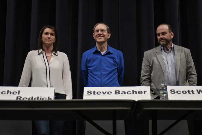Rachel Reddick, Steve Bacher, and Scott Wallace, candidates for the Democratic nomination in the newly-drawn 1st Congressional District, attend a candidate forum in Newtown, Pa. on Tuesday evening. (Bastiaan Slabbers/for WHYY)