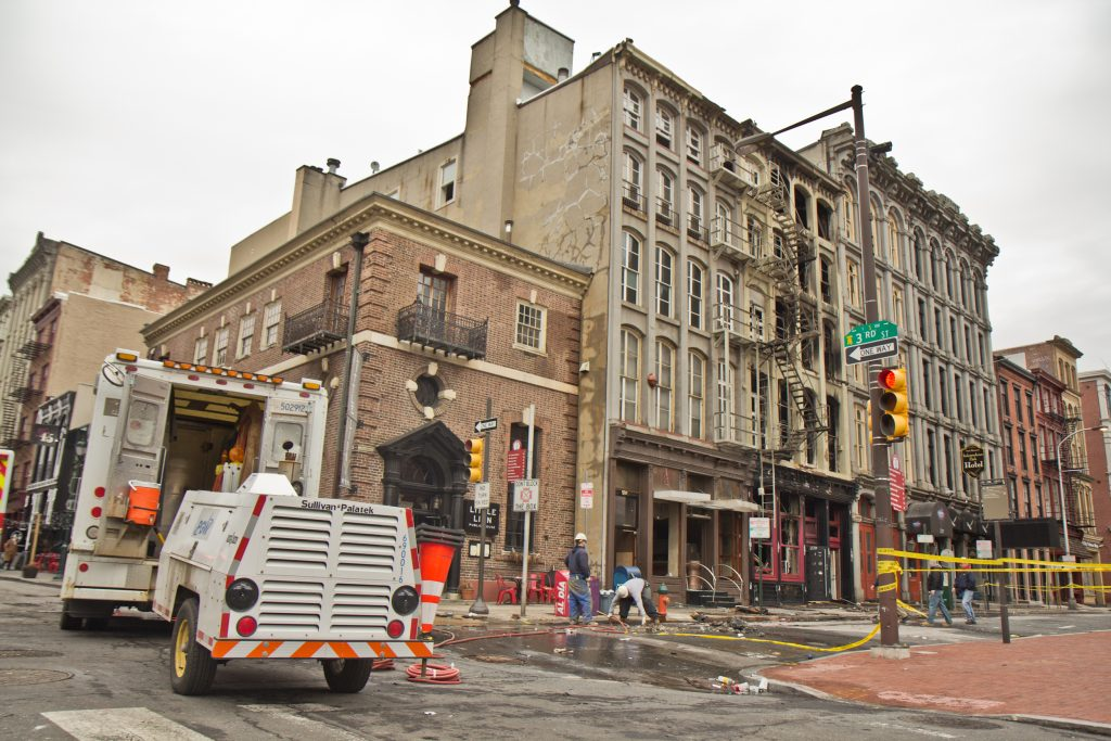 The area 4-alarm fire at 239 Chestnut Street which was contained around 7:30 a.m. this morning is closed off and being evaluated for further risk.