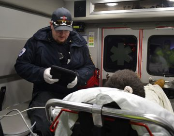 Susquehanna Township EMS Captain Dan Tempel collects information from a man who he just revived from a drug overdose. (Brett Sholtis/Transforming Health)