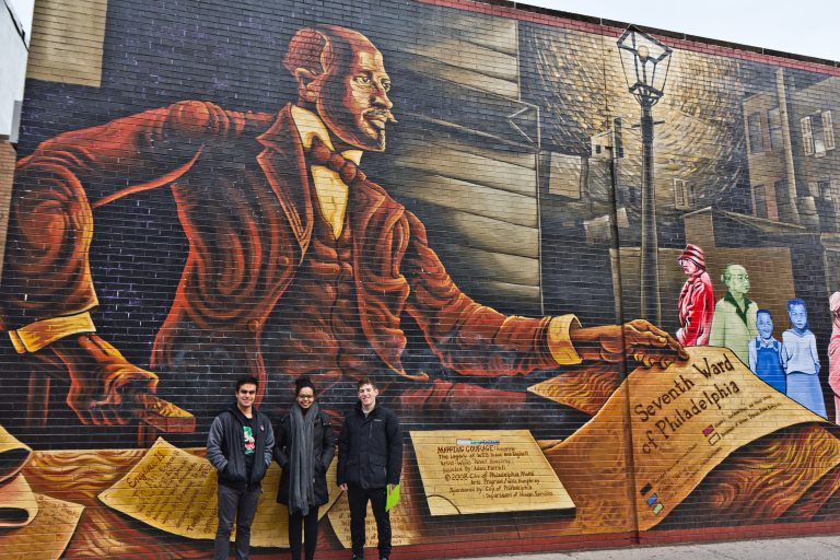 (From left) Penn students Ramon Garcia-Gomez, Helen Fetaw, and Nathaniel Gertzman, tour the 7th Ward. They read about W. E. B. Du Bois and his research in Philadelphia as part of their African American History class. (Kimberly Paynter/WHYY)