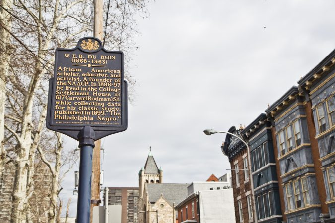 Ramon Garcia-Gomez, a University of Pennsylvania philosophy politics and economics major, said he hopes people will stop and read the historical markers in the 7th Ward. (Kimberly Paynter/WHYY)