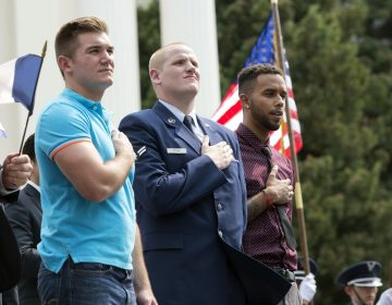 In this Sept. 11, 2015 file photo, Oregon National Guardsman Alek Skarlatos, (left), U.S. Airman Spencer Stone, (center), and Anthony Sadler attend a parade held in their honor in Sacramento, Calif. The wait is almost over to see Roseburg, Ore., hero Skarlatos on the big screen in
