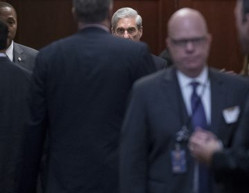 Former FBI Director Robert Mueller, center, the special counsel probing Russian interference in the 2016 election, arrives on Capitol Hill for a closed door meeting, Wednesday, June 21, 2017, in Washington.