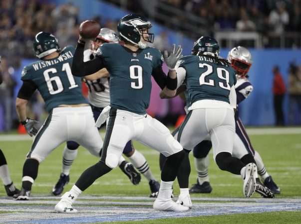 Philadelphia Eagles quarterback Nick Foles (9,) throws against the New England Patriots during the first half of the NFL Super Bowl 52 football game, Sunday, Feb. 4, 2018, in Minneapolis.