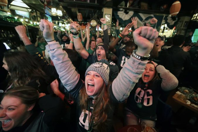 Philadelphia Eagles fans in Philadelphia react while watching the first quarter of the NFL Super Bowl 52 football game between the Eagles and the New England Patriots in Minneapolis, Sunday, Feb. 4, 2018.