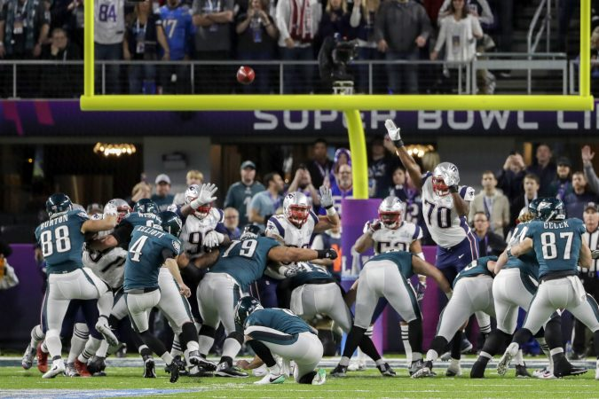 Philadelphia Eagles kicker Jake Elliott (4) kicks a field goal against the New England Patriots, during the first half of the NFL Super Bowl 52 football game Sunday, Feb. 4, 2018, in Minneapolis. Philadelphia Eagles punter Donnie Jones (8), holds. (AP Photo/Chris O'Meara)