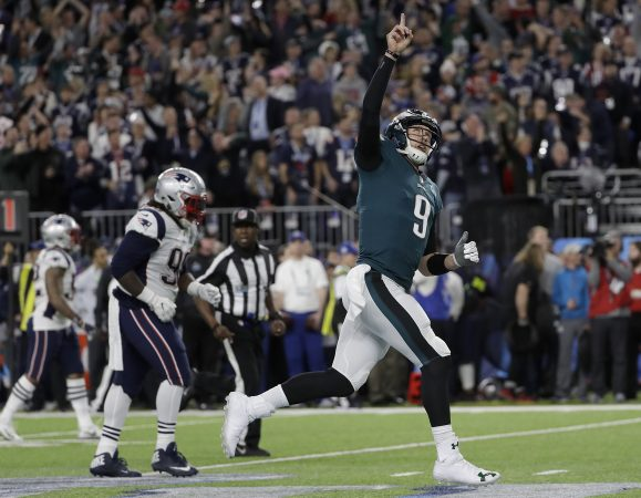 Philadelphia Eagles quarterback Nick Foles (9) celebrates after throwing a touchdown pass to Alshon Jeffery during the first half of the NFL Super Bowl 52 football game against the New England Patriots Sunday, Feb. 4, 2018, in Minneapolis. (AP Photo/Matt Slocum)