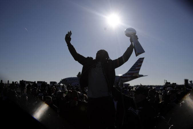 Philadelphia Eagles running back LeGarrette Blount holds up the Vince Lombardi Trophy while displaying it to fans gathered to welcome them in Philadelphia a day after defeating the New England Patriots in Super Bowl 52 in Minneapolis, Monday, Feb. 5, 2018. (AP Photo/Julio Cortez)