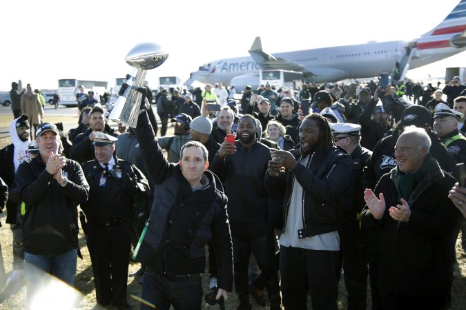 Philadelphia Eagles general manager Howie Roseman holds up the Vince Lombardi Trophy while displaying it to fans gathered to welcome them in Philadelphia a day after defeating the New England Patriots in Super Bowl 52 in Minneapolis, Monday, Feb. 5, 2018. (AP Photo/Julio Cortez)
