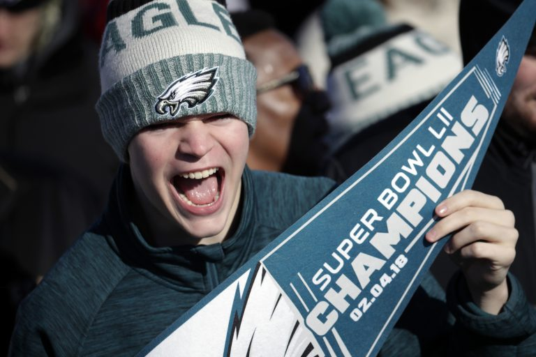 A Philadelphia Eagles fan chants while waiting for the team to arrive in Philadelphia at Philadelphia International Airport a day after defeating the New England Patriots in Super Bowl 52 in Minneapolis, Monday, Feb. 5, 2018. (AP Photo/Julio Cortez)