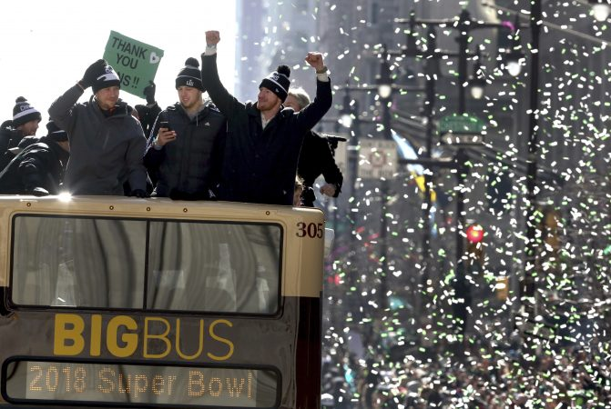 Philadelphia Eagles NFL football team quarterbacks Nick Foles, left, Nate Sudfeld, center and Carson Wentz ride in the Eagles team parade and celebration Thursday Feb. 8, 2018, in Philadelphia. The Eagles defeated the New England Patriots in Super Bowl 52. (AP Photo/Jacqueline Larma)