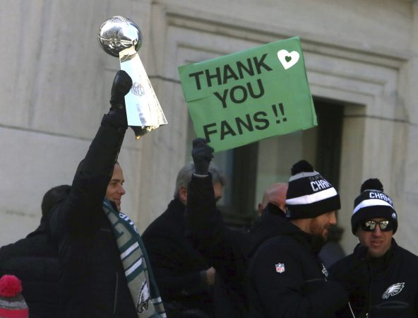 Philadelphia Eagles NFL football team president Don Smolenski holds the Lombardi Trophy as he rides in the Eagles team parade and celebration Thursday Feb. 8, 2018, in Philadelphia. The Eagles defeated the New England Patriots in Super Bowl 52. (AP Photo/Jacqueline Larma)