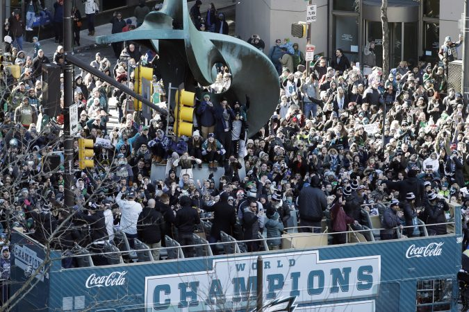 Philadelphia Eagles NFL football players celebrate on a bus passing fans during a Super Bowl victory parade, Thursday, Feb. 8, 2018, in Philadelphia. The Eagles beat the New England Patriots 41-33 in Super Bowl 52. (AP Photo/Matt Slocum)