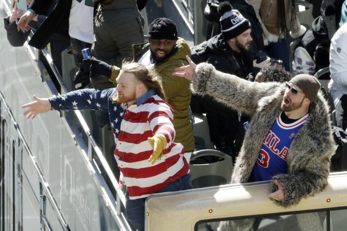 Philadelphia Eagles' Chris Long, from right, Fletcher Cox and Beau Allen celebrate during a Super Bowl victory parade, Thursday, Feb. 8, 2018, in Philadelphia. The Eagles beat the New England Patriots 41-33 in Super Bowl 52. (AP Photo/Matt Slocum)