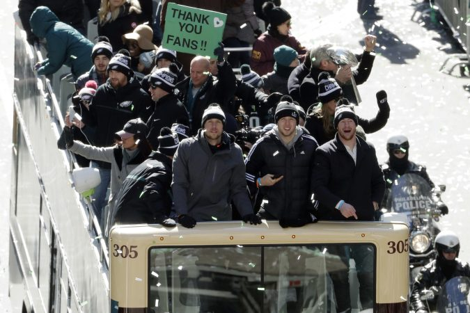 Philadelphia Eagles NFL football team quarterbacks Nick Foles, from left, Nate Sudfeld and Carson Wentz celebrate during a Super Bowl victory parade, Thursday, Feb. 8, 2018, in Philadelphia. The Eagles beat the New England Patriots 41-33 in Super Bowl 52. (AP Photo/Matt Slocum)