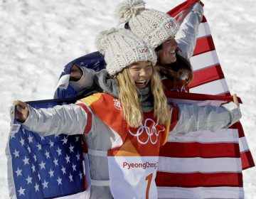 Gold medal winner Chloe Kim, of the United States, (1) and bronze winner Arielle Gold, of the United States, celebrate after the women's halfpipe finals at Phoenix Snow Park at the 2018 Winter Olympics in Pyeongchang, South Korea, Tuesday, Feb. 13, 2018. (AP Photo/Kin Cheung)
