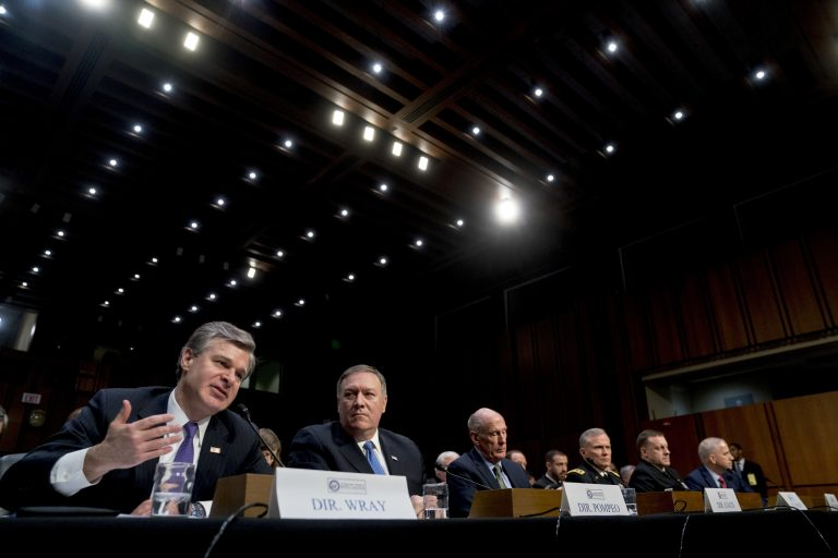 (From left) FBI Director Christopher Wray, accompanied by CIA Director Mike Pompeo, Director of National Intelligence Dan Coats, Defense Intelligence Agency Director Robert Ashley, National Security Agency Director Adm. Michael Rogers, and National Geospatial-Intelligence Agency Director Robert Cardillo, speaks at a Senate Select Committee on Intelligence hearing on worldwide threats, Tuesday, Feb. 13, 2018, in Washington. (Andrew Harnik/AP Photo)