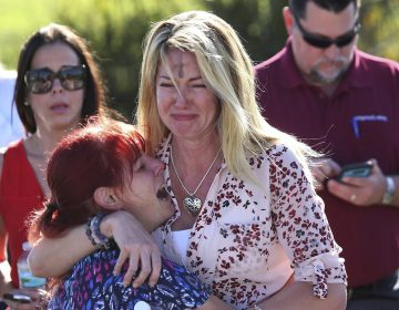 Parents wait for news after a reports of a shooting at Marjory Stoneman Douglas High School in Parkland, Fla., on Wednesday, Feb. 14, 2018. (