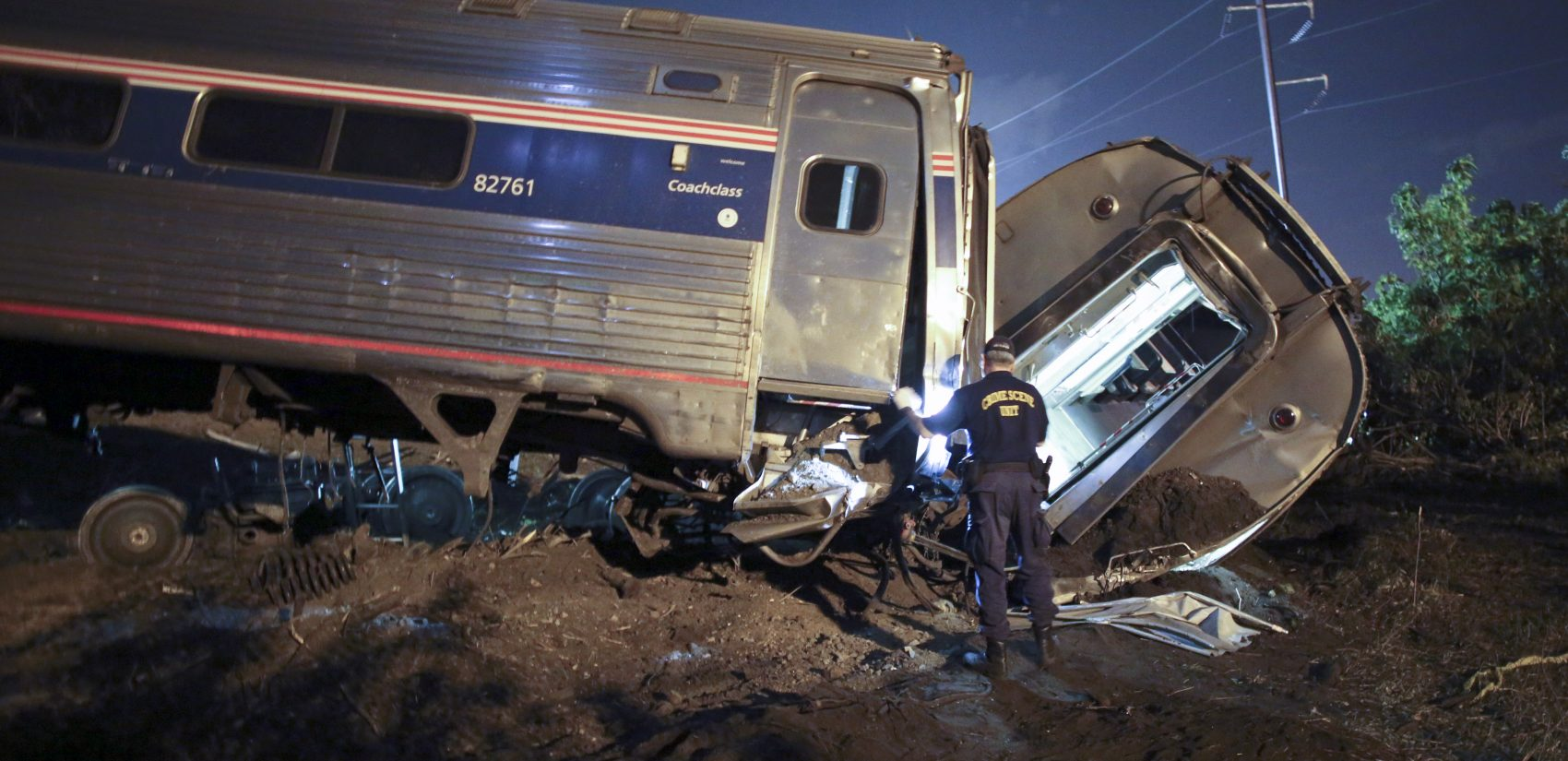 FILE - In this May 12, 2015, file photo, emergency personnel work the scene of a deadly train wreck in Philadelphia. An Amtrak train headed to New York City derailed and crashed in Philadelphia. Federal authorities continue to investigate the crash that killed eight people and injured more than 200. The train derailed while traveling more than twice the speed limit around a curve; travel along the Northeast Corridor was disrupted for days while the tracks were replaced. (AP Photo/ Joseph Kaczmarek, File)