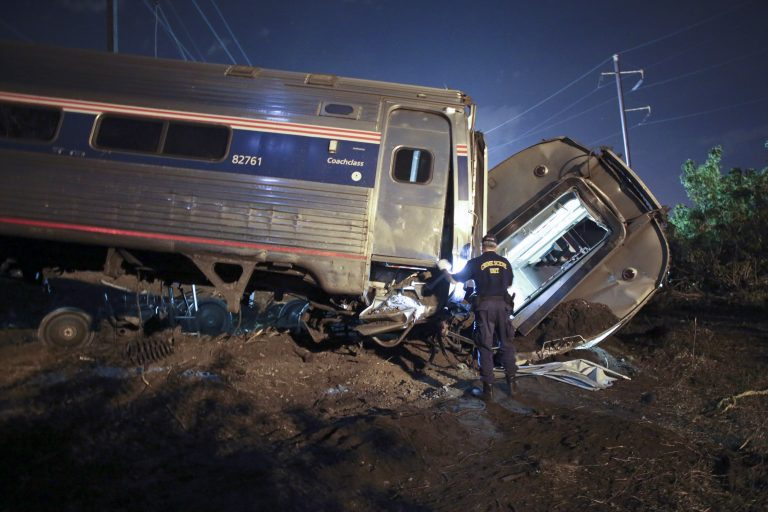 In this May 12, 2015, file photo, emergency personnel work the scene of a deadly train wreck in Philadelphia. An Amtrak train headed to New York City derailed and crashed in Philadelphia. (AP Photo/ Joseph Kaczmarek, File)