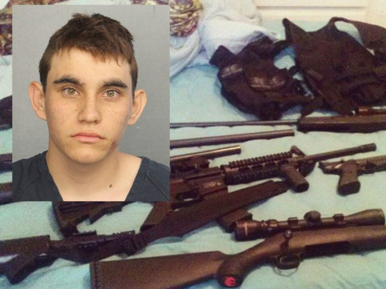 Nikolas Cruz pictured over a photo posted on his Instagram account which shows weapons lying on a bed. Cruz was charged with 17 counts of premeditated murder on Thursday, Feb. 15, 2018, the day after opening fire with a semi-automatic weapon in the Marjory Stoneman Douglas High School in Parkland, Fla. (Broward County Jail and Instagram via AP)