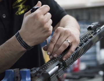 In this photo taken March 15, 2017, Karl Sorken, production manager for Battle Rifle Co., based in Webster, Texas, works on the rails of an AR-15 style rifle. Battle Rifle is one of now more than 10,000 gunmakers in the United States. (Lisa Marie Pane/AP Photo)