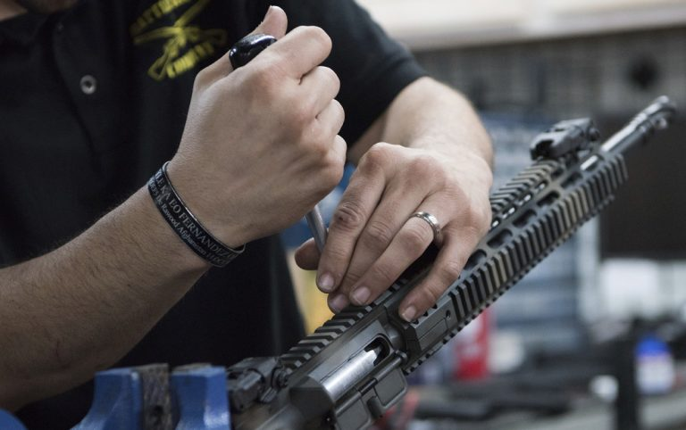 In this photo taken March 15, 2017, Karl Sorken, production manager for Battle Rifle Co., based in Webster, Texas, works on the rails of an AR-15style rifle. Battle Rifle is one of now more than 10,000 gunmakers in the United States. (Lisa Marie Pane/AP Photo)