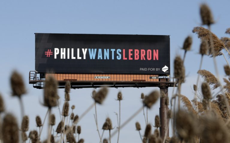 One of three billboards trying to entice Cleveland Cavaliers' LeBron James to come to Philadelphia are shown near a highway, Tuesday, Feb. 27, 2018, in Cleveland.  (Tony Dejak/AP Photo)