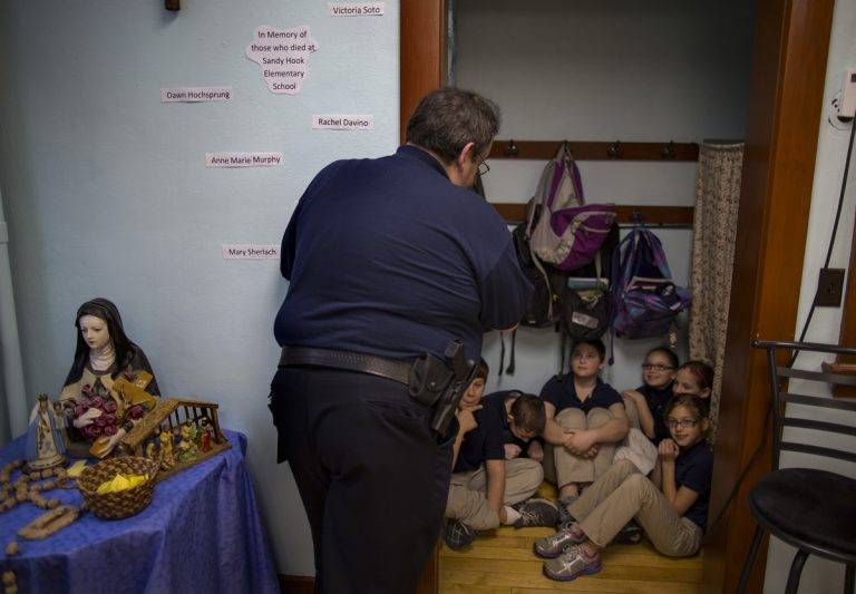 New Washington, Ohio, Chief of Police Scott Robertson talks with fourth grade students as they huddle in closet a during a lockdown drill at the St. Bernard School in New Washington, Ohio, Monday, Jan. 14, 2013. A month after the shootings of 20 students and six educators a the Sandy Hook Elementary School in Newtown, Conn., St. Bernard School principal Susan Maloy, inspired by the memories of those who lost their lives, has decided to hold lockdown drills on the 14th of each month to refine a safety plan and increase school security. (Craig Ruttle/AP Photo)
