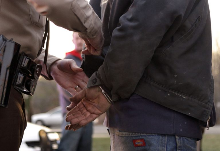 In this Dec. 23, 2010 file photo, a police officer arrests a man during a crackdown on illegal purchases of over-the-counter cold medications  (Jeff Roberson/AP Photo, File)
