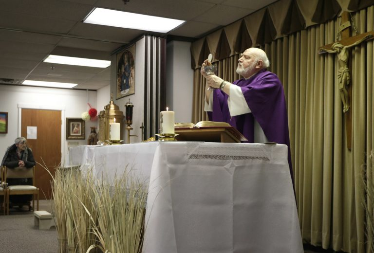 The Rev. Eugene Bettinger celebrates Mass at the Chapel on the Mall on Ash Wednesday last year in Paramus. New Jersey has the second-highest concentration of Catholics in the country.  (Seth Wenig/AP Photo)