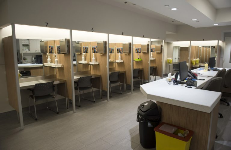 Booths line the Cactus safe-injection site where drug addicts can shoot up using clean needles, get medical supervision, and freedom from arrest in Montreal.  (Paul Chiasson/The Canadian Press via AP)